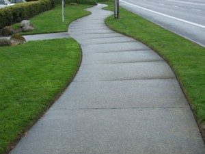 sidewalk with landscaped edging grass